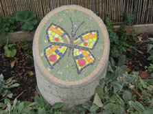 butterfly mosaic on concrete pillar